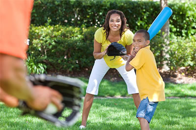 Family able to enjoy playing wiffle ball after a chiropractic adjustment corrected a pinched nerve.