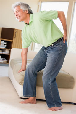 Man with sciatica getting up off the couch